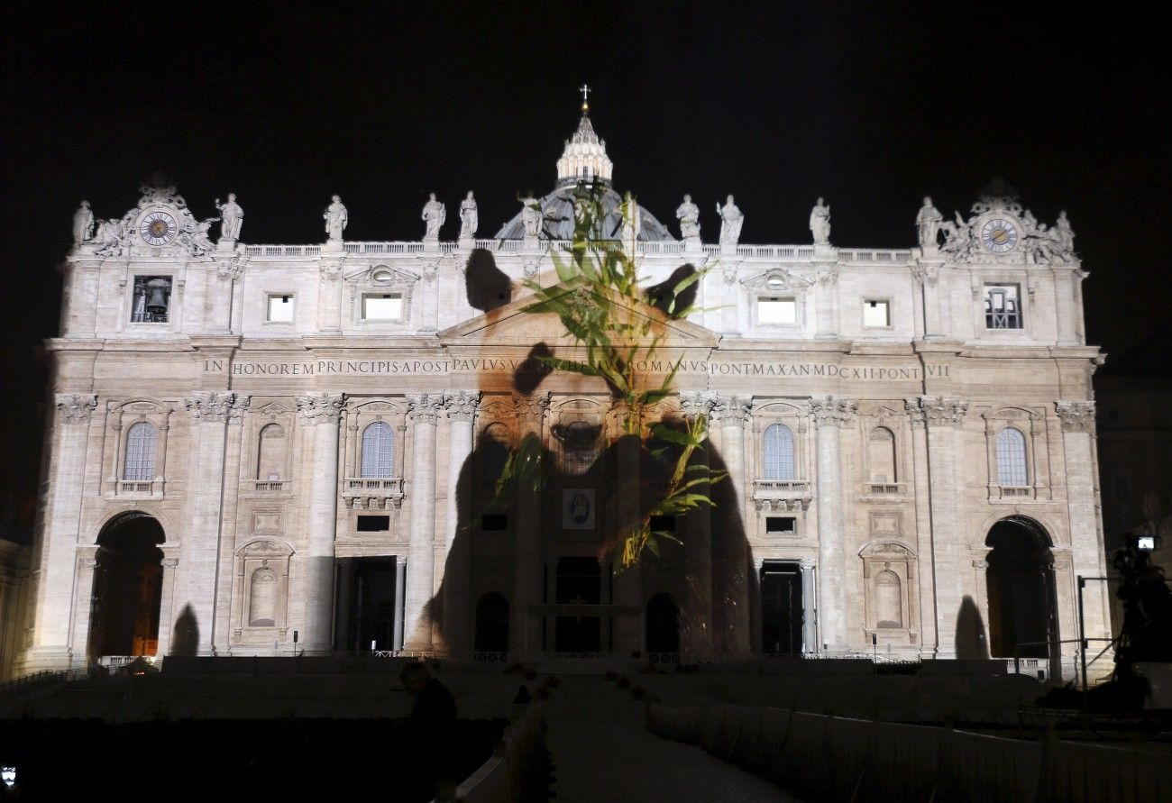 "A picture of a panda, part of an art projection featuring images of humanity and climate change artistically rendered by Obscura Digital, is projected onto the facade of St. Peter's Basilica, as part of an installation entitled ""Fiat Lux: Illuminating our Common Home"" as a gift to Pope Francis on the opening day of the Extraordinary Jubilee, at the Vatican, December 8, 2015. REUTERS/Stefano Rellandini FOR EDITORIAL USE ONLY. NO RESALES. NO ARCHIVE. - RTX1XT46"