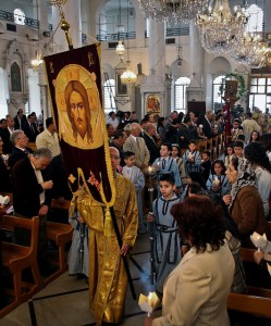 FILE - In this Sunday, April 15, 2012 file photo, Syrian Orthodox Christians attend Easter mass in Damascus, Syria. Christians, who make up about 10 percent of Syria's population of more than 22 million, say they are particularly vulnerable to the violence that has been sweeping the country since March 2011. They are fearful that Syria will become another Iraq, with Christians caught in the crossfire between rival Islamic groups. (AP Photo/Bassem Tellawi, File)